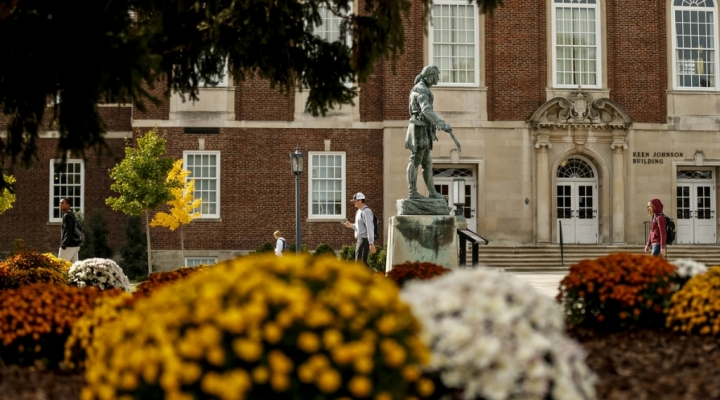 With flowers in bloom, a student walks on EKU's campus.