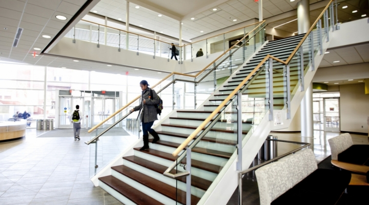 A student walks down the stairs in the new Science Building